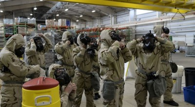 Watch: Airmen from the 12th Aircraft Maintenance Unit assemble a Reaper drone in full MOPP gear