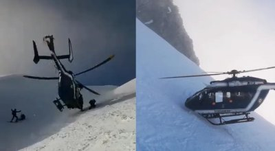 Watch: Incredible footage of helicopter pilot putting rotor within inches of a mountain to rescue skier in the Alps