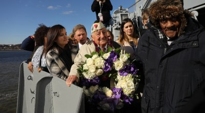 NEW YORK, NEW YORK - DECEMBER 07: Local Pearl Harbor survivors Armando 'Chick' Galella, 97, (left) and Reverend James Blakely, 99, prepare to throw a wreath off of the USS Intrepid at an event marking the 77th Anniversary of the attack on Pearl Harbor on December 07, 2018 in New York City. Japanese bombers attacked Pearl Harbor on December 7, 1941 resulting in the deaths of 1,177 crew members on the US Arizona. The attack prompted the United States to declare war on Japan and shortly after Germany. (Photo by Spencer Platt/Getty Images)