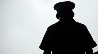 Silhouette of a United States Marine praying, photographed from behind. (Getty Images)