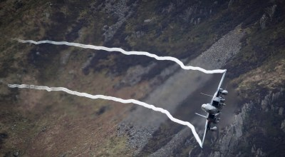 A U.S. Air Force F-15 fighter jet based at RAF Lakenheath speeds through the Dinas Pass, known in the aviation world as the Mach Loop on February 16, 2018 in Dolgellau, Wales. United Kingdom. The Royal Air Force and aircraft of the United States use the valleys of Snowdonia to practice low flying techniques and pilot training. The mountain peak vantage points attract aviation enthusiasts from all over the world who hope for a glimpse of their favorite military aircraft spending days waiting for the un-published and un-scheduled flybys.  (Photo by Christopher Furlong/Getty Images)
