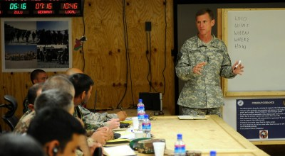 "U.S. Army Gen. Stanley McChrystal, commander of International Security Assistance Force speaks to members of Task Force Bayonet during a visit to Forward Operating Base Shank, March 10. McChrystal discussed current operations and the future of the counter-insurgency fight in Afghanistan. ""Were here, not to fight the war, but were here to win,"" said McChrystal. ""And we win through the people."" Pfc. Michael Sword. DVIDS."