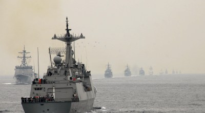 "The ROKS Gangkamchan (DDH 979) steams by a line of Repulic of Korea Navy (ROKN) ships during the International Fleet Review ""Pass and Review."" (WikiMedia Commons)"