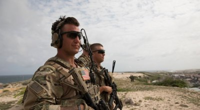 U.S. Army soldiers look out at Mogadishu, Somalia. (Source: James Peterson)