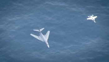 Watch: B-1B Lancers join Super Hornets in three-carrier flyover