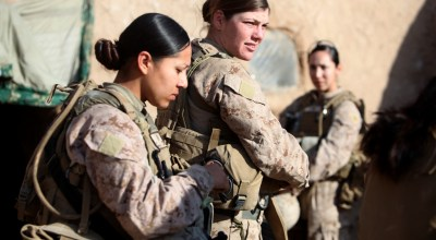 U.S. Marine Corps Sgt. Jessica Domingo, right, and Cpl. Daisy Romero, assigned to a female engagement team (FET), speak with an Afghan man in his compound during a patrol in Marjah, Helmand province, Afghanistan, Dec. 30, 2010. (USMC Photo)