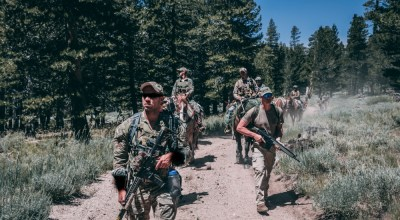 Operational Detachment Alpha Special Forces Soldiers and Marines with 1st Marine Raider Support Battalion conduct movement to a Landing Zone for a low altitude drop resupply at Marine Corps Mountain Warfare Training Center, Bridgeport, Calif., Aug 5, 2018. The purpose of this training was for Army Special Forces and MARSOC to improve upon their joint training techniques. (U.S. Marine Corps photo by Lance Cpl. William Chockey).