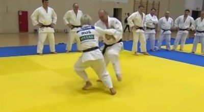Russian President Valdimir Putin with the national judo team. (YouTube)