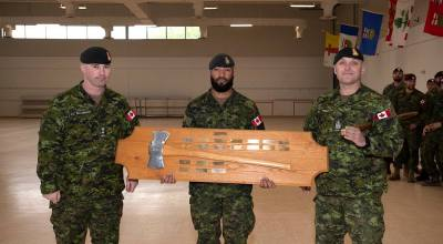 Lieutenant-Colonel Scott MacGregor, Commandant Infantry School; Sergeant Quincy Smith (3rd Battalion, Princess Patricia's Canadian Light Infantry), Top Candidate of the Basic Assault Pioneer course given in June 2018; Chief Warrant Officer Sylvain Isabelle, Regimental Sergeant Major, Infantry School. The Axe symbolizes a tradition for the Pioneers and is awarded to the Top Candidate. Photo: Corporal Roger Simard, Canadian Army Combat Training Centre. ©2018 DND/MDN Canada.
