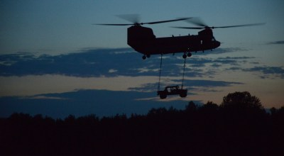 A U.S. CH-47F Chinook helicopter assigned to Bravo Company, 1st Battalion, 214th Aviation Regiment, 12th Combat Aviation Brigade conducts sling load procedures at the 7th Army Training Command's Grafenwoehr Training Area, Germany, July 27, 2018. (U.S. Army photo by Christoph Koppers)