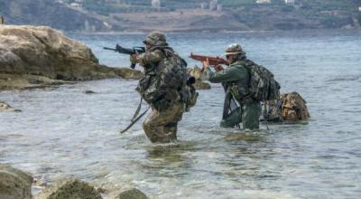 Hellenic Navy special forces perform maritime bi-lateral training exercises in Souda Bay, Crete. U.S. special operations forces, Hellenic Navy special forces, and Hellenic forces participated in bi-lateral training exercises in September 2018 to strengthen their partnership and share knowledge. (U.S. Navy photo by Joel Diller).
