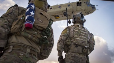 U.S. Air Force pararescuemen, assigned to the 83rd Expeditionary Rescue Squadron, prepare to board a U.S. Army CH-47F Chinook during a training mission in Afghanistan on March 15, 2018. Pararescuemen conduct training on combat, medical procedures, and search and rescue to hone their skills, providing the highest level of personnel recovery capabilities to commanders throughout the Combined Joint Operations Area. (U.S. Air Force photo by Senior Airman Nathaniel Stout)