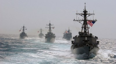 The guided missile destroyer USS Porter (DDG 78) (right) leads the way during divisional tactics training along with the guided missile destroyers USS McFaul (DDG 74), USS Arleigh Burke (DDG 51) and USS Cole (DDG 67), and the guided missile cruisers USS Cape St. George (CG 71) and USS Anzio (CG 68) in the Atlantic Ocean, on March 5, 2005. (DOD photo by Lt. J.G. Caleb Swigart, U.S. Navy)