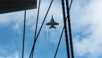 Super Hornet soars over the USS Dwight D. Eisenhower in the Atlantic
