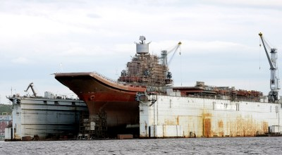 Pictured in this file image dated August 7, 2010, is the Russian aircraft carrier Admiral Kuznetsov at the PD-50 floating dry dock of Shipyard 82. The PD-50 floating dry dock of the shipyard sank while the Russian aircraft carrier Admiral Kuznetsov was leaving it on the night of October 29 to 30, 2018. Several people were injured in the accident. (Photo by Lev Fedoseyev\TASS via Getty Images)
