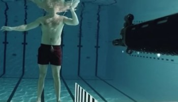 Watch: Physicist fires submerged SIG SG 550 rifle at himself to show how water stops bullets