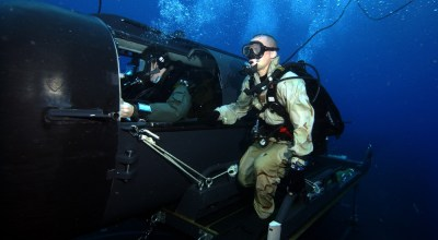 A Navy diver and special operator from SEAL Delivery Team (SDV) 2 perform SDV operations with the nuclear-powered guided-missile submarine USS Florida (SSGN 728) for material certification. Material certification allows operators to perform real-world operations anytime, anywhere. (U.S. Navy Photo courtesy of DVIDS).