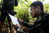In the burning heat of midday in the jungle, Saw Htoo Htoo Wah scrutinizes his map to find the most efficient route to the next land navigation point.
