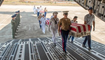 Honors procession in Laos for possible remains of unknown US service members