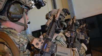 U.S. Army Green Berets assigned to the 7th Special Forces Group (Airborne) (7th SFG(A) stack up and prepare to enter a room during an exercise in Belize, 2014. U.S. Army Photo by Staff SGT. Roman Madrid, 241st Mobile Public Affairs Detachment/Released