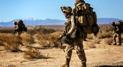 Marines with 1st Battalion, 5th Marines patrol towards their objective during an airfield seizure exercise as a part of Exercise Steel Knight 2014 at Marine Corps Air Ground Combat Center Twentynine Palms, Calif., Dec. 11, 2013. (U.S. Marine Corps photo by Cpl. Justin A. Bopp)