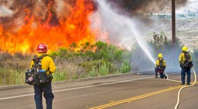 Firefighters with the Camp Pendleton Fire Department combat a fire in the Santa Margarita/De Luz Housing area on Marine Corps Base Camp Pendleton, California, on July 6, 2018. (Marine Corps photo by Cpl. Dylan Chagnon)