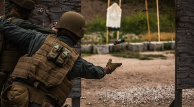 A Marine Corps Air Station Miramar Special Reactions Team (SRT) member throws a flash bang grenade during training at MCAS Miramar, Calif., May 15. The Marines conducted this training to hone their skills in close quarters combat and further familiarize themselves with the M1911 Service Pistol. (U.S. Marine Corps photo by Sgt. Jake McClung).