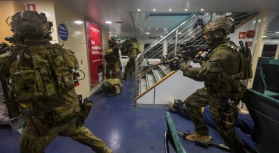 Australian Army soldiers from 2nd Commando Regiment conduct a clearance of a Sydney ferry during counter-terrorism training on Middle Harbour, Sydney, in May 2019. (Image courtesy of the Australian Defence Force).