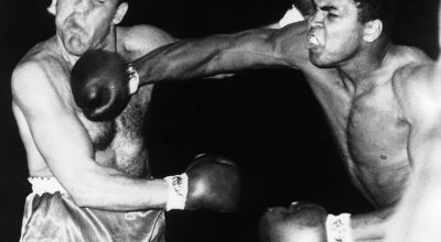 Boxing legend Muhammad Ali delivers a knockout punch to Brian London. (Source: Wikimedia Commons)