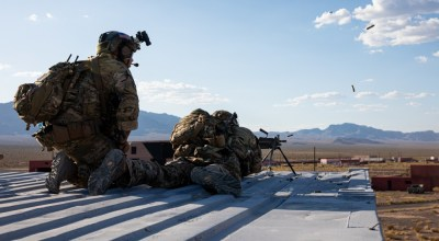 Green Berets assigned to 3rd Special Forces Group (Airborne) engage targets with the M249 machine gun during a training event near Nellis Air Force Base, Nev. Aug. 27, 2019. U.S. Special Forces and U.S. Air Force Joint Terminal Attack Controllers conducted a raid and utilized multiple weapon systems ranging from smalls arms weapons to A-10 Thunderbolt ll aircraft. (U.S. Army photo by Sgt. Steven Lewis).