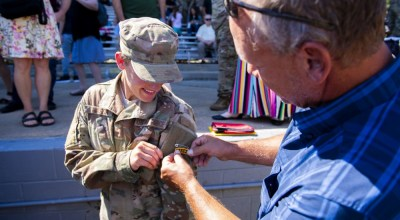 First Lt. Chelsey Hibsch, 821st Contingency Response Squadron, receives her Ranger tab after graduating from the U.S. Army Ranger School Aug. 30, 2019, at Fort Benning, Georgia. Hibsch became the first Air Force female in history to graduate the two-month course. (U.S. Army photo by John Tongret)