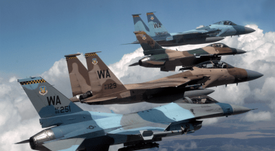 A flight of Aggressor F-15 Eagles and F-16 Fighting Falcons fly in formation 5 June over the Nevada Test and Training Ranges. (U.S. Air Force photo/Master Sgt. Kevin J. Gruenwald)