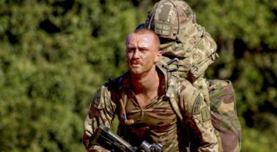 Royal Marine Commando during a ruck march. (Image courtesy of the British Ministry of Defence).