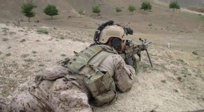 A Navy SEAL providing fire support during a village search in Afghanistan. (Image courtesy of NSWC).
