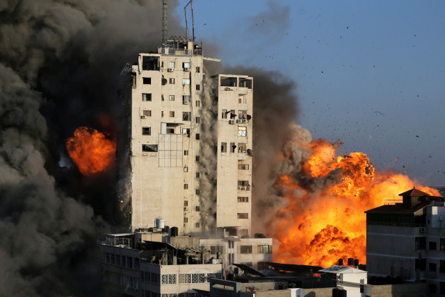 A building housing Hamas operations is engulfed in fireballs following an Israeli Air Force strike.