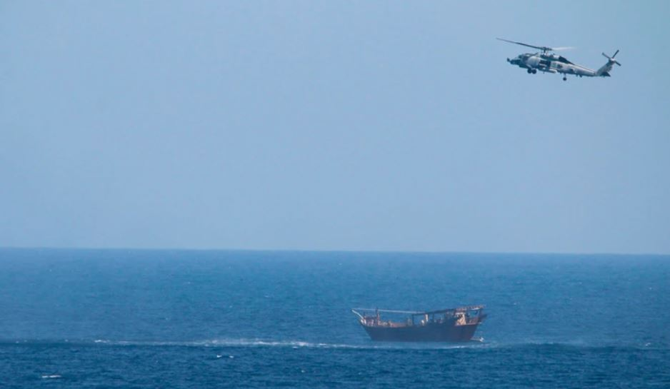 A Navy Seahawk helicopter approaches a dhow that was en route to Yemen carrying a cache of illegal weapons. (U.S. Navy)