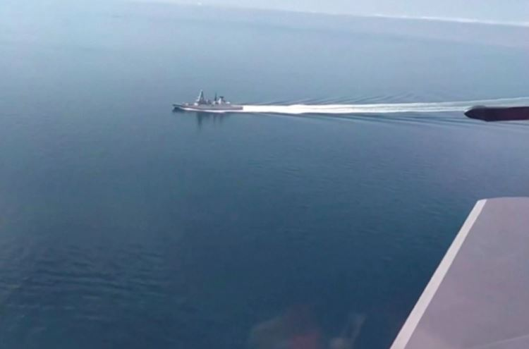 HMS Defender being shadowed by a Russian SU-24 attack aircraft