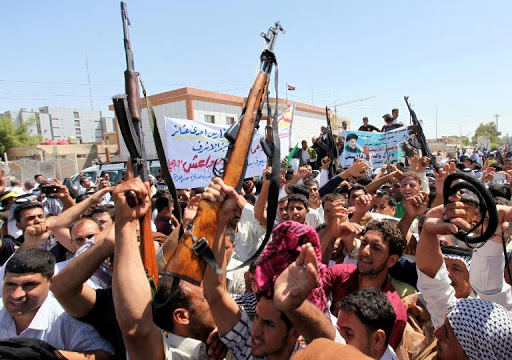 A Middle Eastern mob. Prominent in the centre is an SKS rifle held by one of the men.