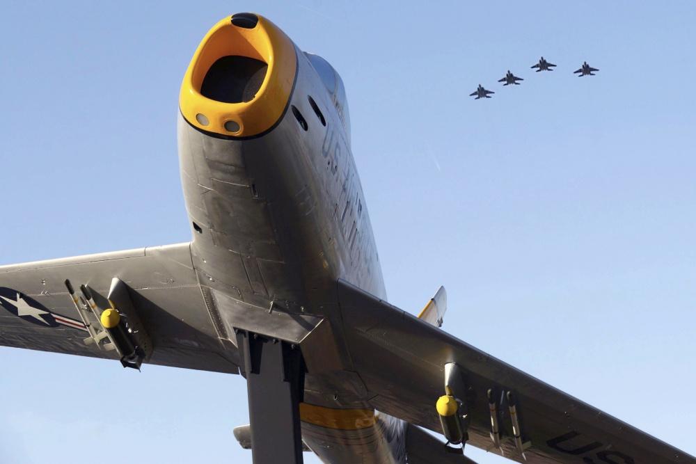 F-15E Strike Eagles and an F-86 Sabre
