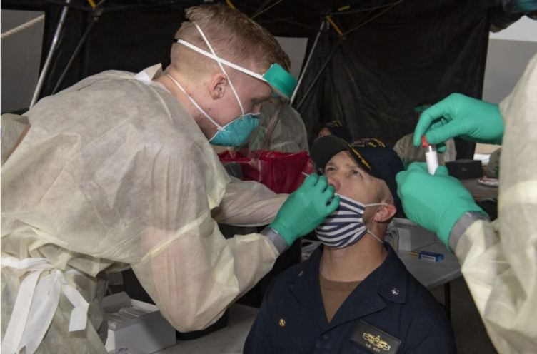 Navy personnel being tested for COVID-19.