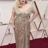 Gold, Rebel, gold ... Australian actress Rebel Wilson owns the red carpet. Picture: AP
