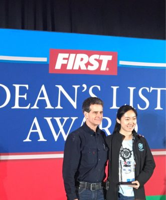 Dean Kamen presents Grace her Dean's List award at FIRST Robotics Championship