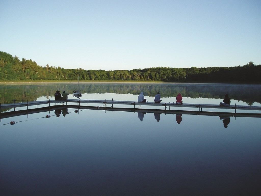 Campers on the docks of the lake at Camp Helen Brachman