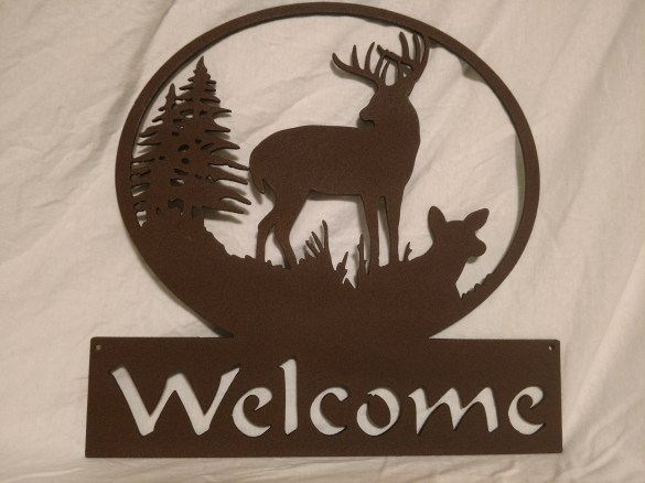 buck family welcome painted brown