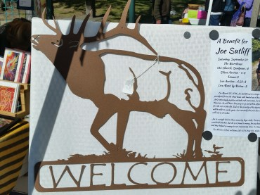 large elk welcome painted in brown