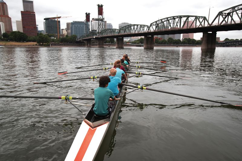 PORTLAND TRIBUNE: JAIME VALDEZ - A young crew team departs from the dock near the Portland Boathouse to row along the Willamette River.