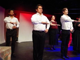 Muhammed Saed, (left back) Preston Jones (left front), Jocelyn DeHass, (right back) and Eric Bechtold, right front) take the stage moments before the performance starts. (Hilary Broman/CNM Chronicle).