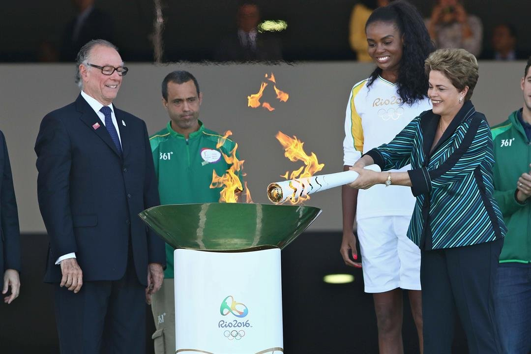 Brazilian president Dilma Rousseff lights the Olympic torch at the presidential palace in Brasilia Tuesday, May 3, 2016.