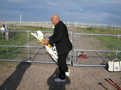Oblate Father Carl Kabat, 76, prepares to hang a banner on the fence around a nuclear armed missile in northern Colorado Aug. 6. (Courtesy St. Louis Catholic Worker)