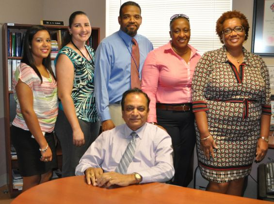 Public Health administration staff (L to R): Amber Martinez, Sarah Frederick, Timothy McLaughlin – Munroe, Therese Prehay, Nola Sanderson and  Dr Kiran Kumar (seated)